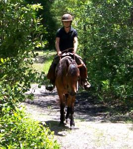 Girl trail riding