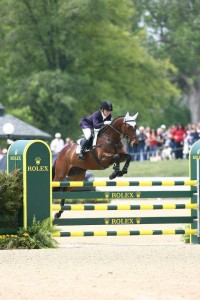 woman jumping bay horse at Rolex