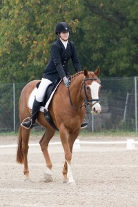 woman on chesnut dressage horse
