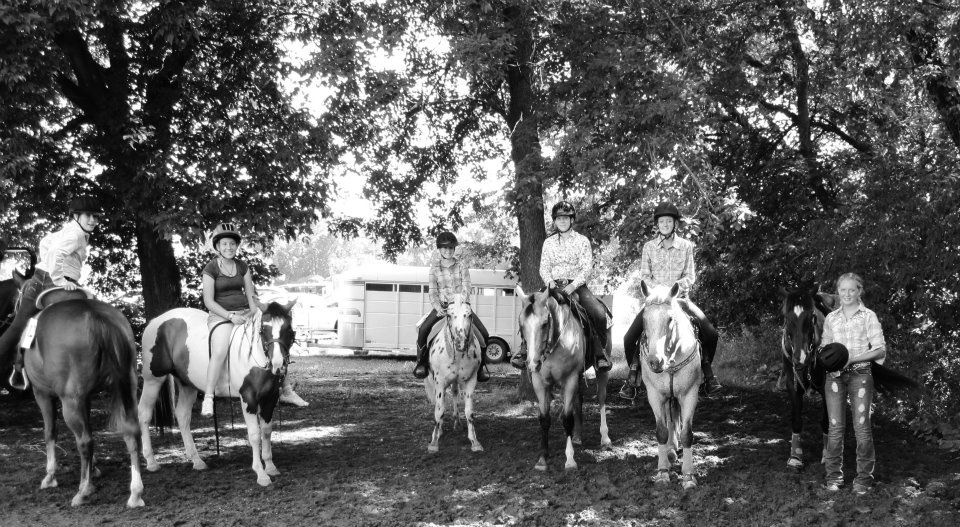 Black and white photo of 6 women on horseback