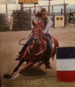 woman on sorrel barrel horse