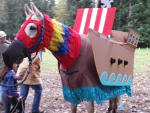 horse dressed in parrot costume
