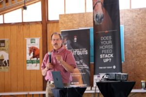 Man presenting about the horses gut