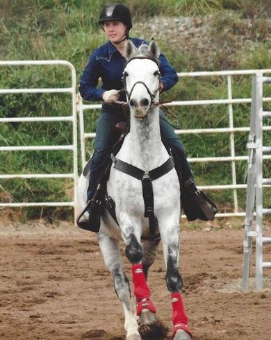 Woman on dappled gray horse