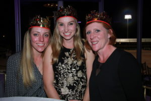 three women smiling at party