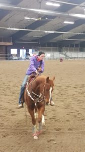 Woman riding sorrel horse