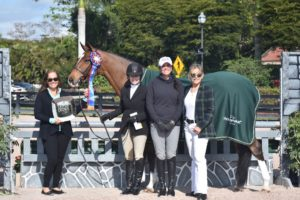 Woman receiving Triple Crown Excellence Award