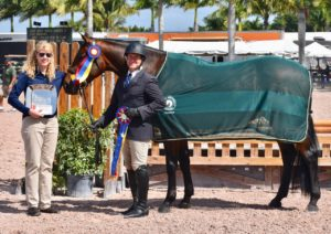 Winner of Triple Crown Excellence Award with bay horse