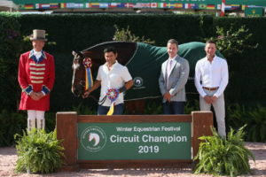 Man winning Triple Crown Division Championship with bay horse