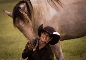 Woman with bucksin paint horse