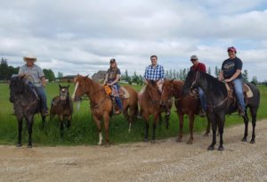 Family of five trail riding